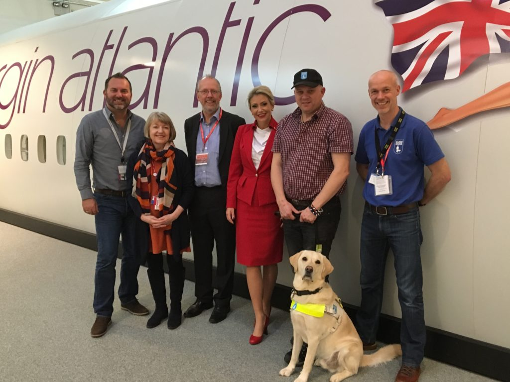 Photo showing some of the Bluebox aIFE development team members from Bluebox, Virgin Atlantic and Guide Dogs