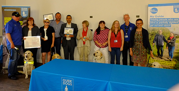 Photo of members of Bluebox aIFE collaboration team from Bluebox, Virgin Atlantic and Guide Dogs